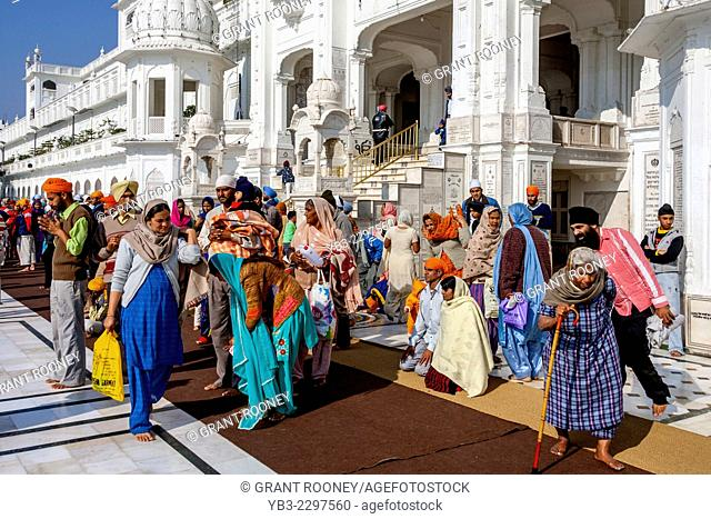 Sikh People At The Golden Temple of Amritsar, Punjab, India