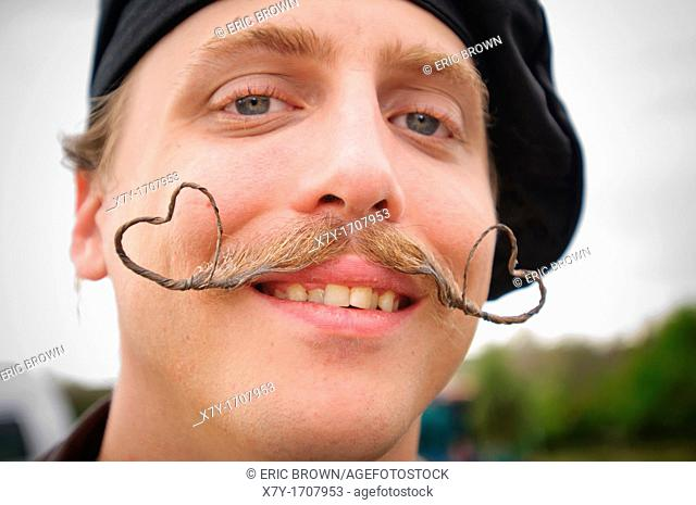Competitor with moustache styled into hearts, at the 2010 USA National Beard and Moustache Championships in Bend, OR, USA  June 5, 2010