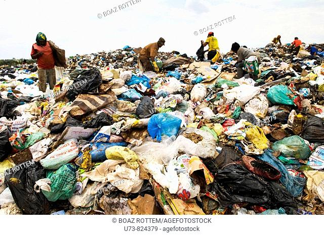 workers in the big garbage dump near Brasilia