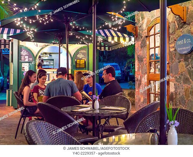 People at outdoor restaurant and bar in Cruz Bay on the Caribbean Island of St John in the US Virgin Islands