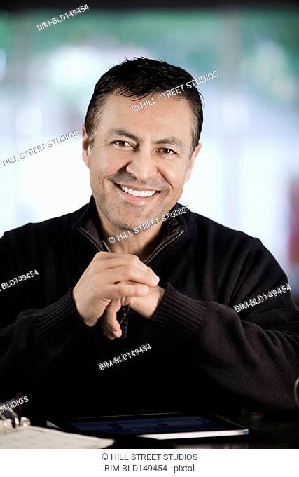 Smiling Hispanic businessman