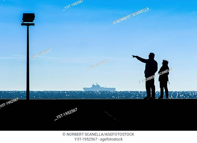 Europe, France, Var, Giens Peninsula. Couple of Tourists on the dock