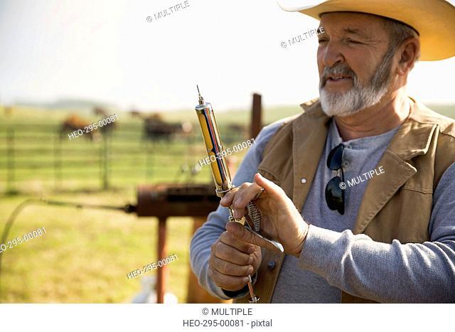 Cattle rancher preparing vaccination