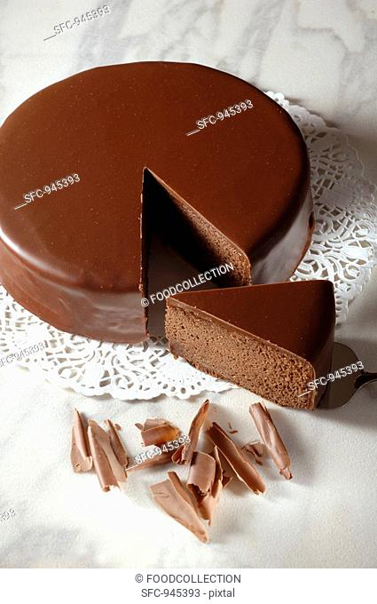 Sachertorte Austrian chocolate cake with a piece cut