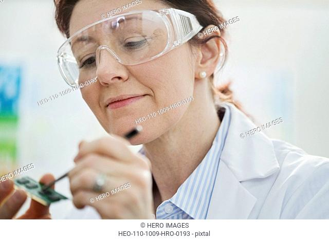 Female lab technician testing micro-chip