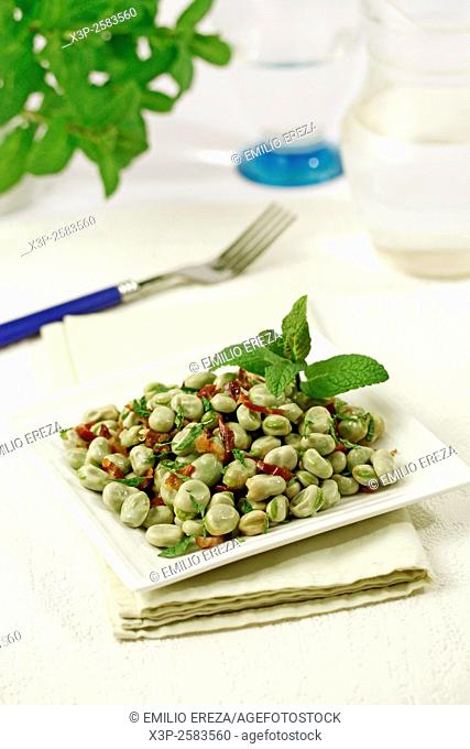 Fresh broad beans with ham and mint