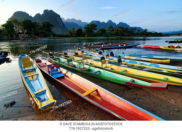 boats along the Nam Song River in Vang Vieng, Laos