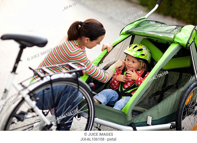 Mother and daughter biking outdoors