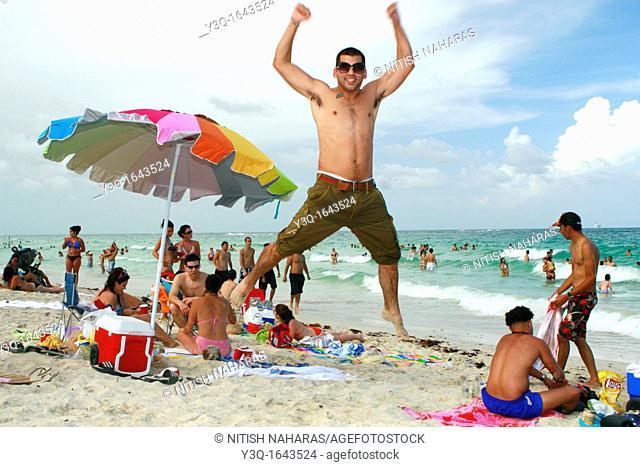 Colorful beach scene on South Beach in Miami, FLorida, USA