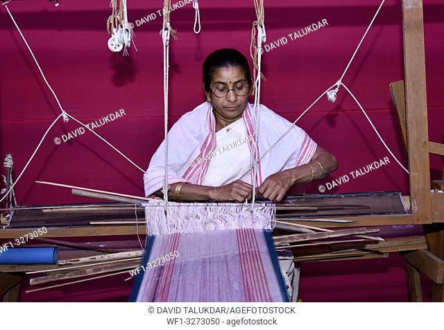 Guwahati, Assam, india. 8 March 2019. Women weaving Assamese Traditional gamosa agead of Rongali Bihu in Assam