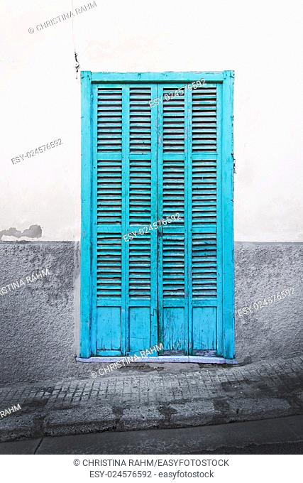 Green door on rustic wall in Palma de Mallorca, Balearic islands, Spain