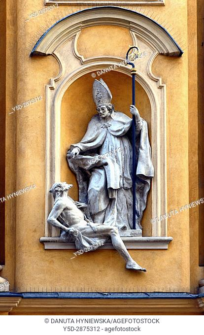 Architectural detail - symbols in arts - Saint Martin helps poor man, St. Martin's Church - Kosciol Sw. Marcina, located on ulica Piwna - Beer Street in the...