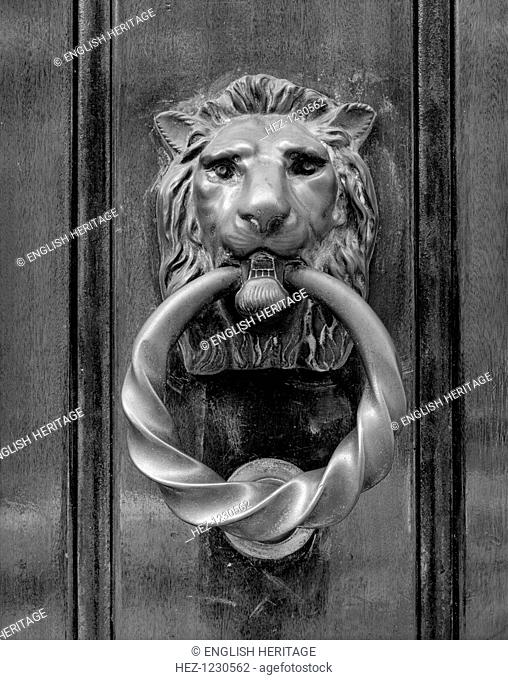 Door knocker in the form of a lion's head holding a ring in its mouth, at Selwyn House, Cleveland Row, Westminster, London, 1979