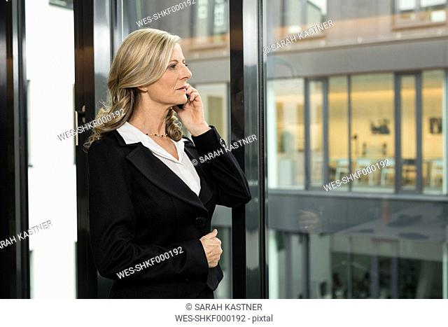 Serious businesswoman on cell phone