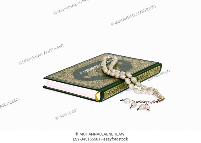 Holy Quran and rosary beads