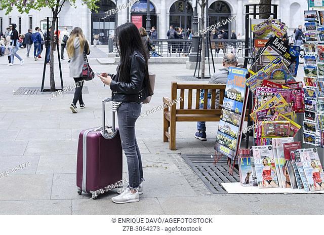 Tourist in Plaza de la Ópera, Madrid city, Spain