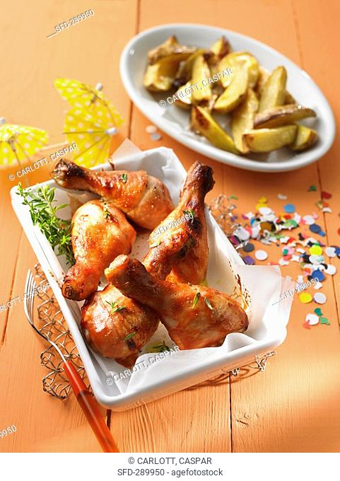 Roasted chicken drum sticks and potato wedges