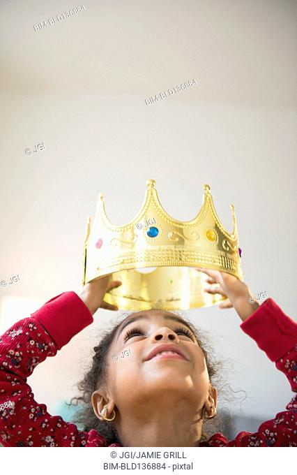 African American girl wearing gold crown