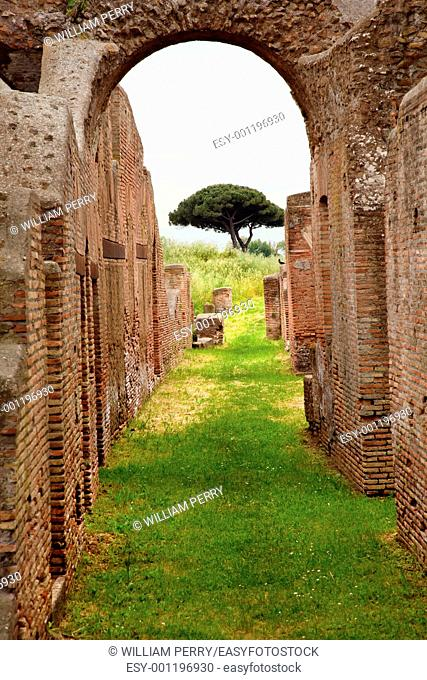 Ancient Roman Arch Walls Street Ostia Antica Ruins Rome Italy Excavation of Ostia, ancient Roman port, next to airport  Was port for Rome until 5th Century AD