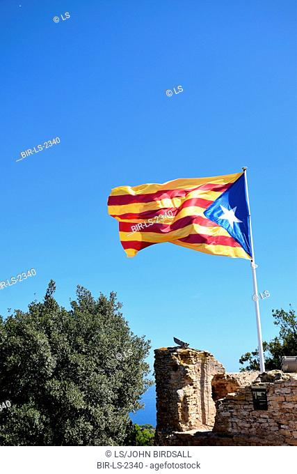 Catalonia, Spain Sep 2017. Catalan flag on top of Begur Castell. On 1 October Catalans will go to the polls to vote in a referendum on whether to secede from...
