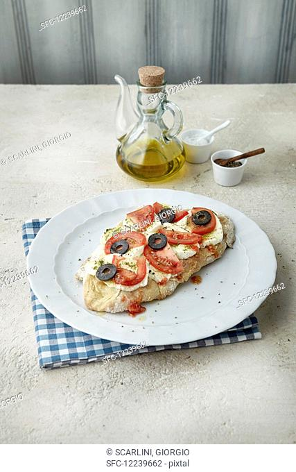 Focaccia with mozzarella, tomatoes and olives