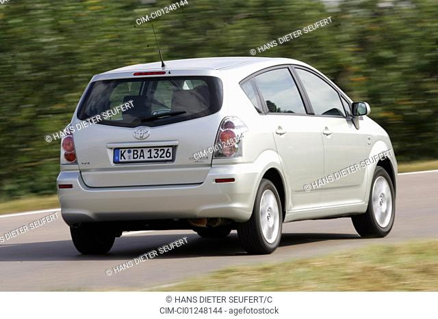 Toyota Corolla Reverse 1.8 VVT-i Executive, model year 2005-, silver, driving, diagonal from the back, rear view, country road