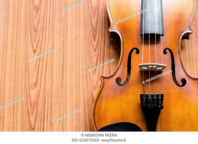 string instrument violin on wood background