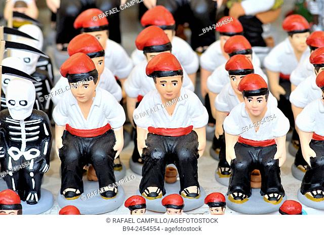 'Caganers', particular feature of modern nativity scenes at Santa Llucia Christmas fair, Barcelona. Catalonia, Spain