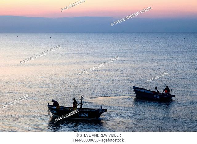 England, West Sussex, Bognor Regis, Fishermen Departing at Dawn