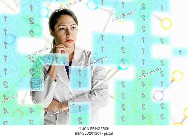 Mixed race scientist looking at numbers
