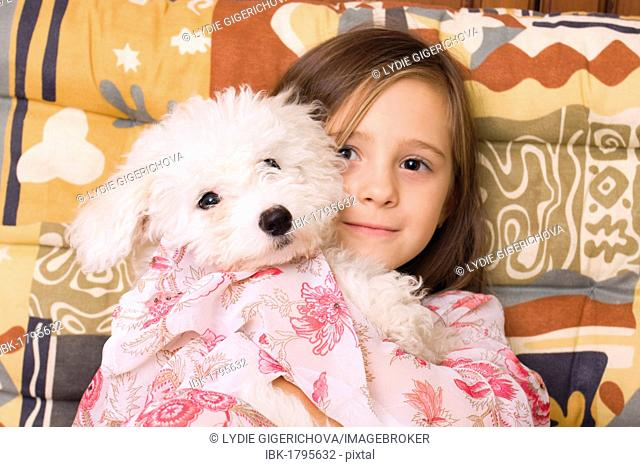 Girl, 4 years, with puppy