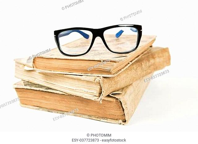 old antique books and glasses on white background