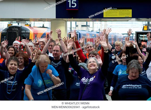 London Hospices Choir Flash Mob Waterloo promoting Christmas single 'The Living Years' at Waterloo Station Featuring: Atmosphere, View Where: London, England