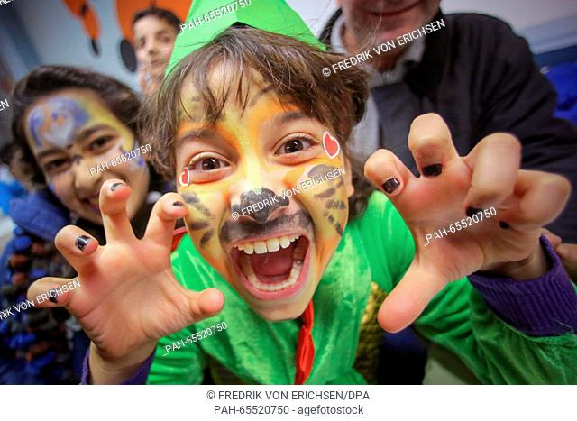 A young girl from Syria with a painted face participating in an information event on the carnival tradition in an accomodation for refugees in Mainz, Germany