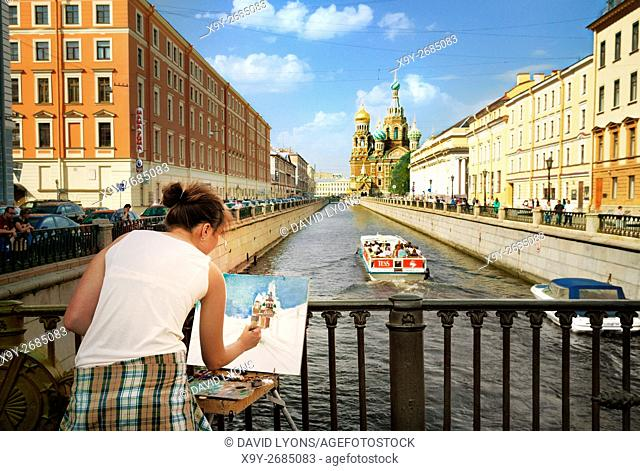 Saint Petersburg Russia. Artist painting view of Church of the Saviour on Spilled Blood along the Griboedov Canal. Summer