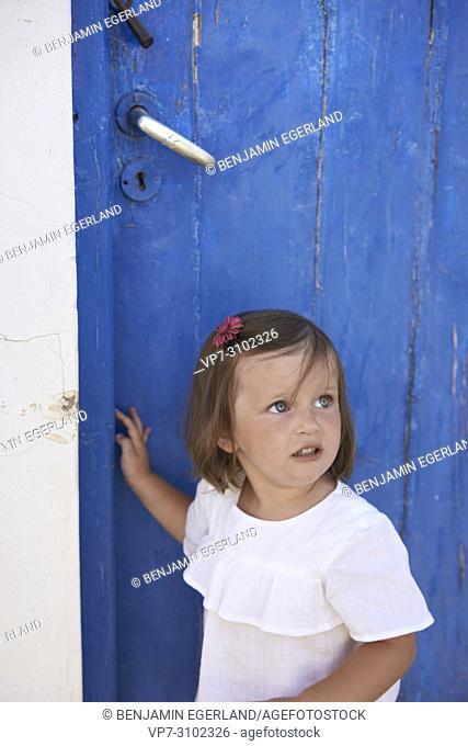 toddler at door, childhood