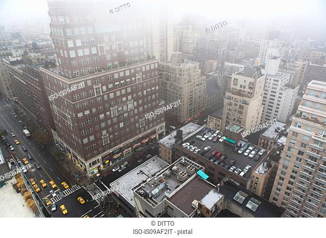 High angled cityscape in mist, New York City, USA
