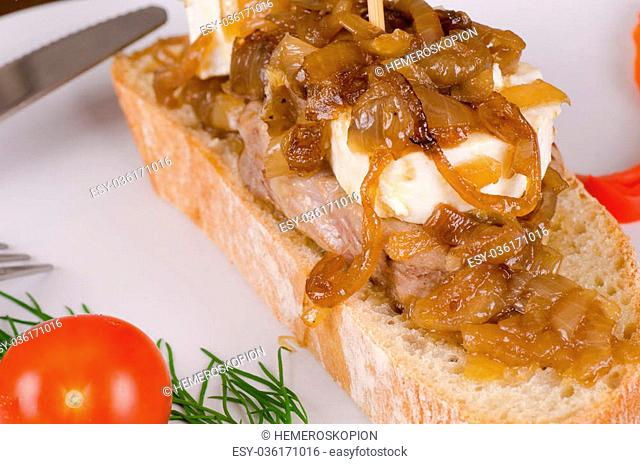 Pork loin with goat cheese and caramelized onions, Spanish tapa