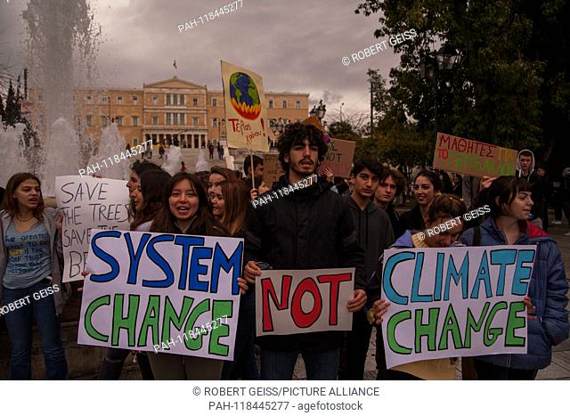 """Greek students during rally against climate change in front of Parliament. Signs """"""""System change no climate change"""""""". 15.03.2019 