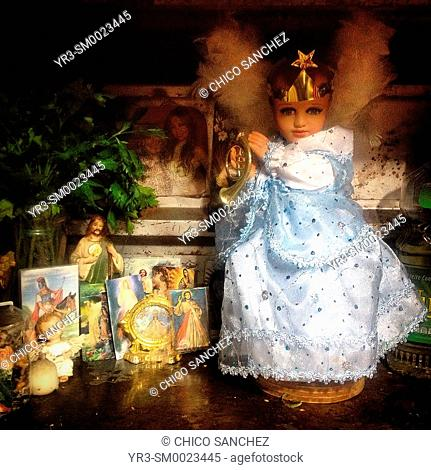 An altar with a Baby Jesus and other saints decorate a house in Colonia Roma, Mexico City, Mexico