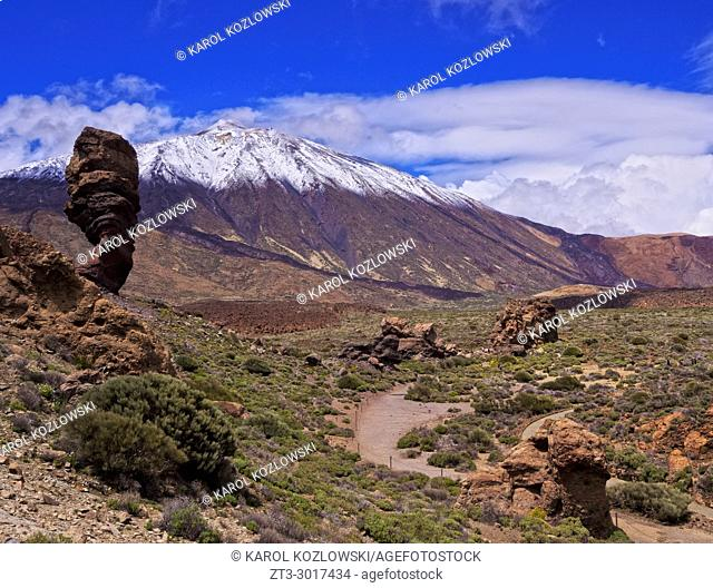 Teide Mountain covered with snow and Roques de Garcia, Teide National Park, Tenerife Island, Canary Islands, Spain
