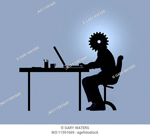Office worker at desk with cog head