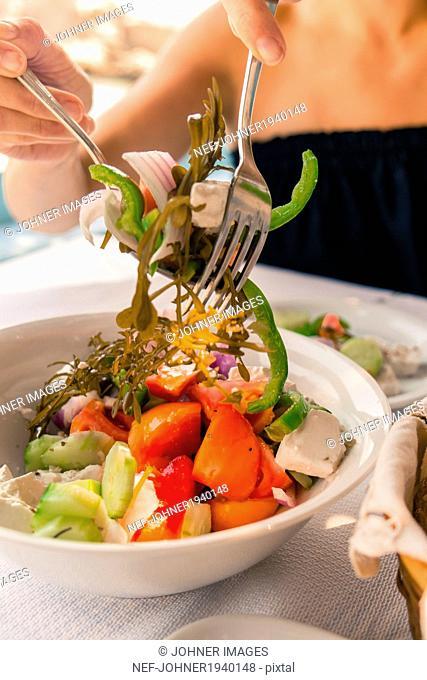 Woman having salad