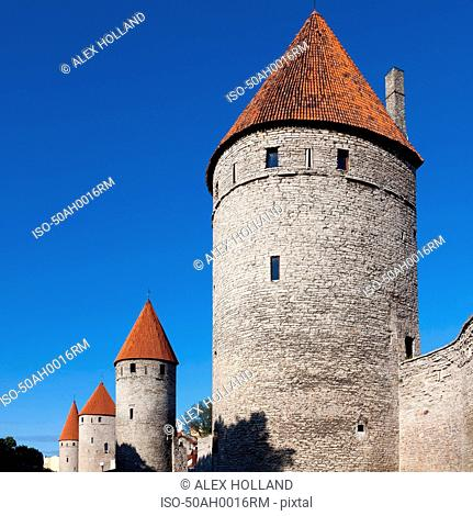 Medieval city wall with windows