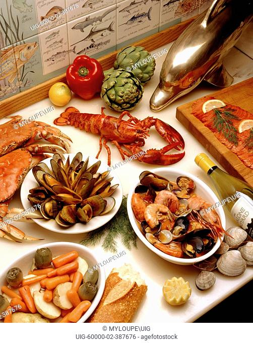 Tabletop of fresh cooked LOBSTER, CRAB, MUSSELS, CLAMS & SHRIMP with some VEGETABLES