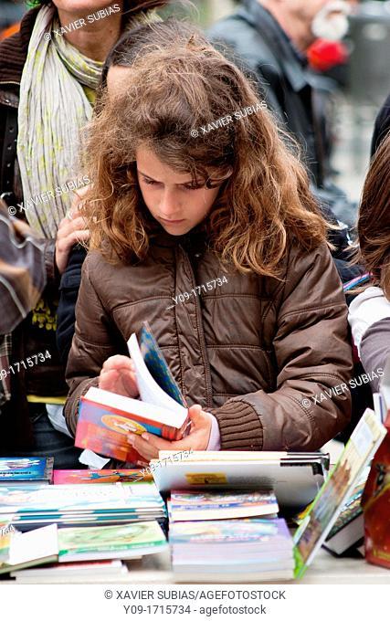 Diada de Sant Jordi, Girl in the book stall, Barcelona, Catalonia, Spain