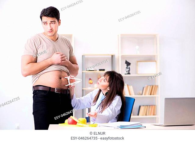 Doctor dietician giving advices to fat overweight patient