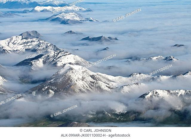Aerial view of fog rolling over the northern edge of the Brooks Range in Gates of the Arctic National Park & Preserve, Arctic Alaska, Summer