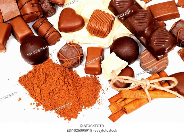 Many chocolate and cinnamon isolated on white background