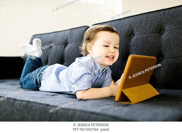 Young boy (4-5) using tablet